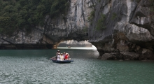 Halong-Bay-Tours-Visit-fishing-village-by-row-boat-high